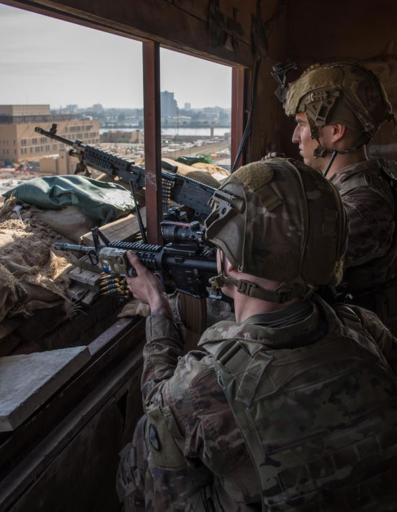 US Army Soldiers provide armed overwatch at the U.S. Embassy Compound in Baghdad, Iraq, Jan. 1, 2020.